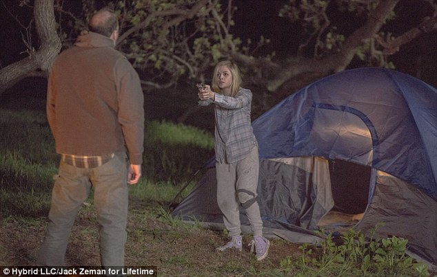 A still from the Lifetime movie shows Hannah pointing a gun at her abductor. A promo read: 'As the dust settled, questions began to emerge about the nature of the relationship between Hannah and her kidnapper...and what really happened?'