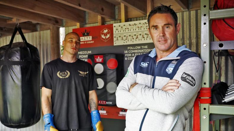 NSW Origin coach Brad Fitlerm pictured at his backyard gym with young boxer Mateo Tapia says PCYCs could be playing a significant role in the lives of young people. Picture: Sam Ruttyn