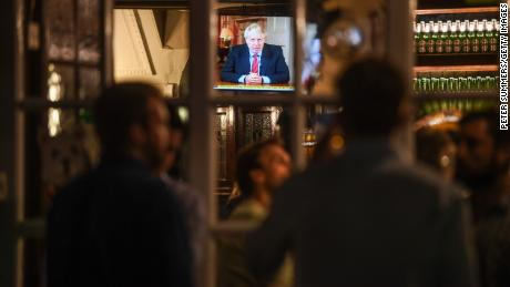 British Prime Minister Boris Johnson was spotted drinking at the Westminster Arms Bubble in London during a televised speech on Tuesday.