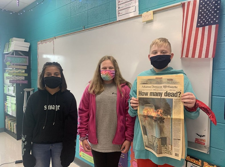 Every year on Sept. 11, Cutter Morning Star School District shares local newspapers that were released after the 9/11 attacks. From left are sixth-graders Maliyah Garner, Kenzie Geurin and Garrett Duncan. - Submitted photo