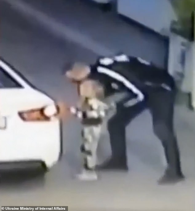 CCTV footage shows a man dressed in black coaxing four-year-oldElizaveta Kolisnichenko into the back of a white car inBoryspil, around 25 miles east of Kiev, Ukraine