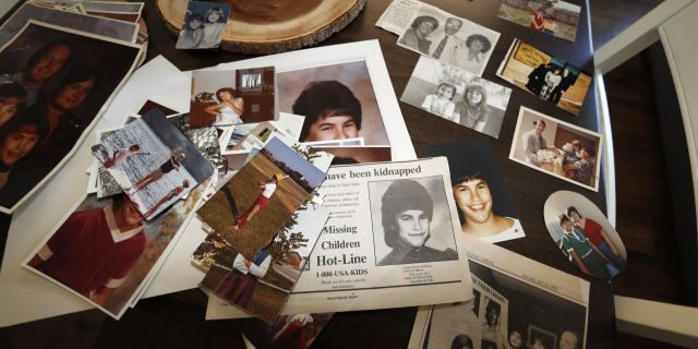 In this Monday, Aug. 12, 2019, photograph, family photographs of Jonelle Matthews, who went missing just before Christmas 1984 and whose remains were found in Greeley, Colo. in 2019, sit on a table in a home in Greeley. (AP Photo/David Zalubowski, File)