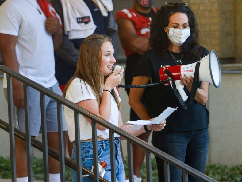 (Leah Hogsten   The Salt Lake Tribune) Highland High School student Grace Conde addresses the crowd during a July 15, 2020 rally. Raina Williams, a mother, stands behind her, to the right.