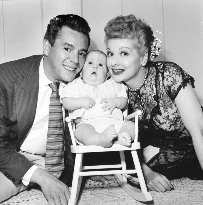 Lucille Ball and Desi Arnaz with Desi Arnaz Jr. | KM Archive/Getty Images