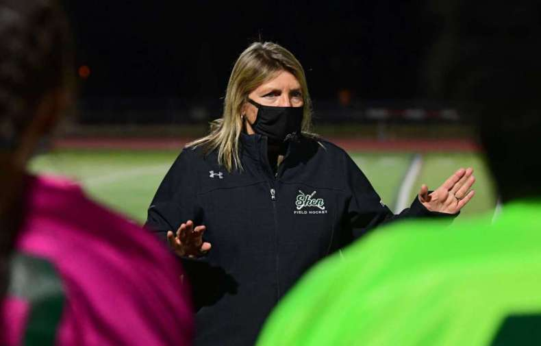 Shenendehowa head coach Jeanne Frevola talks to her team at halftime during the Suburban Council field hockey final against Burnt Hills on Friday, Nov. 20, 2020 in Clifton Park, N.Y. (Lori Van Buren/Times Union)