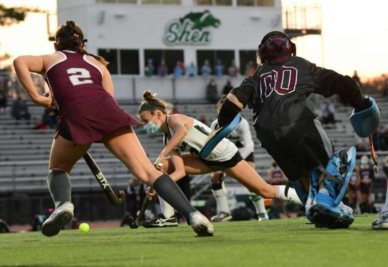 Shenendehowa's Kendall Eggleston, center, scores the first of her two goals against Burnt Hills in the Suburban Council field hockey final on Friday, Nov. 20, 2020 in Clifton Park, N.Y. (Lori Van Buren/Times Union)