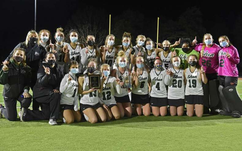 Shenendehowa celebrates with their trophy plaque after defeating Burnt Hills 3-0 in the Suburban Council field hockey final on Friday, Nov. 20, 2020 in Clifton Park, N.Y. (Lori Van Buren/Times Union)