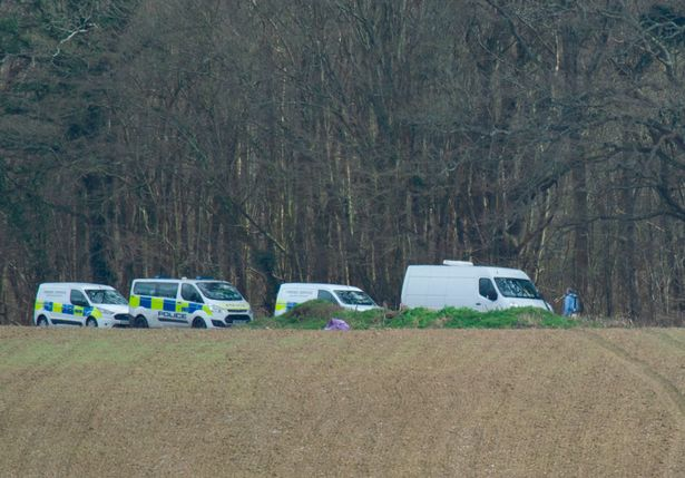 A heavy police presence in the woods where human remains were found in the search for Sarah Everard