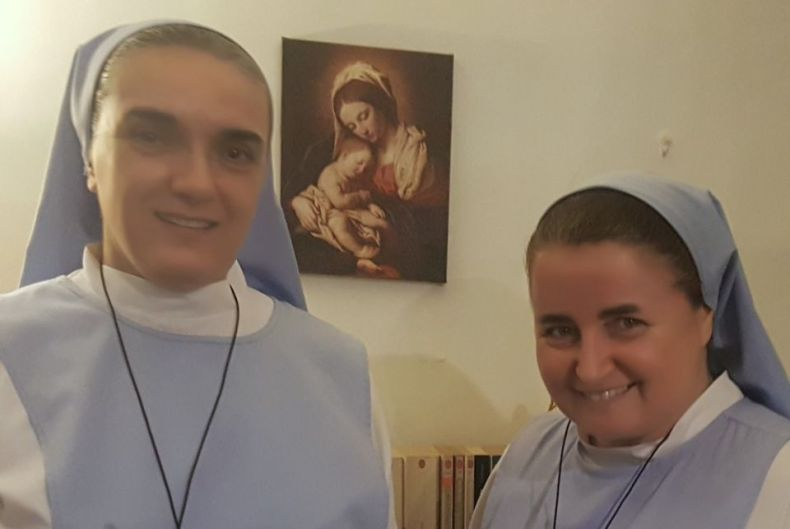 Two Catholic sisters in habits standing in a room together, Sr. Edith Fabian, left, and Sr. Sophie de Jésus