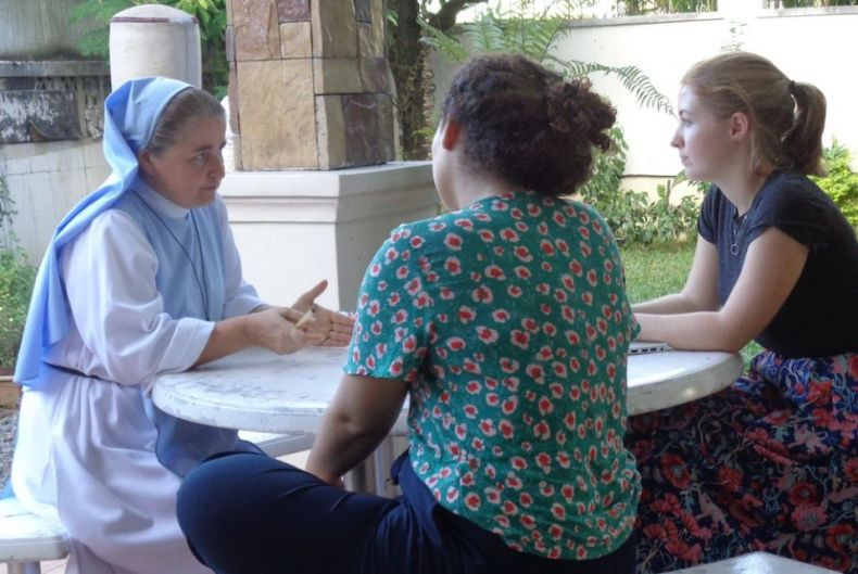 Sr. Sophie de Jésus, left, meets visitors in the garden of the School of Life, a residential program for girls ages 15 to 21 in Quezon City, part of metropolitan Manila, in December 2019. (Charity Durano)