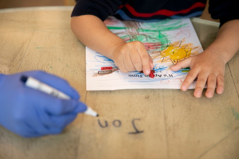 Jonathan, 4, works on a coloring activity during online preschool at his home in Tracy on March 3, 2021. Jonathan, who is on the autism spectrum, is aided by a one-on-one therapist three days a week who helps with online learning and behavioral issues. Photo by Anne Wernikoff, CalMatters