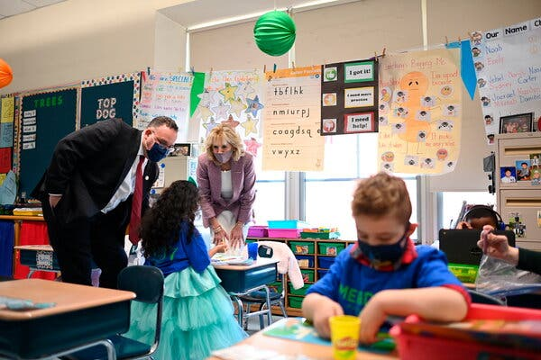 The first lady, Jill Biden, and the education secretary, Miguel Cardona, visited the Benjamin Franklin Elementary School in Meriden, Conn. on Wednesday.