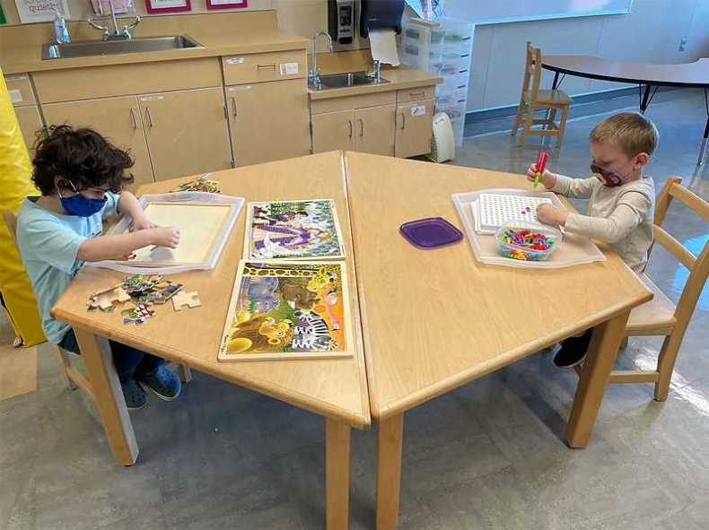 COURTESY PHOTO - Kindergartners work on art projects as they returned to school this month for the first time in a year at the Gladstone Center for Children & Families.