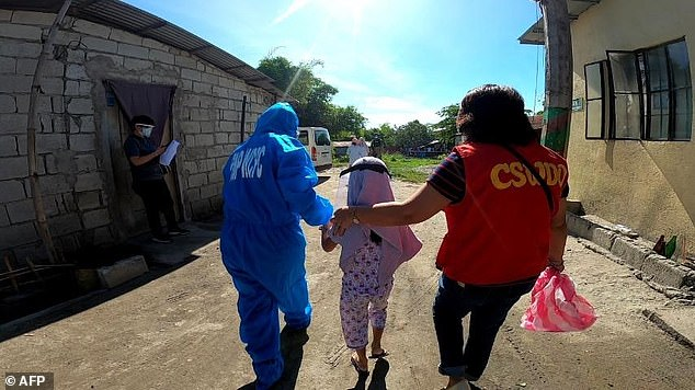 This image shows the rescue of children from a similar alleged den of abuse in Angeles City, about two hours' drive from Manila, in February