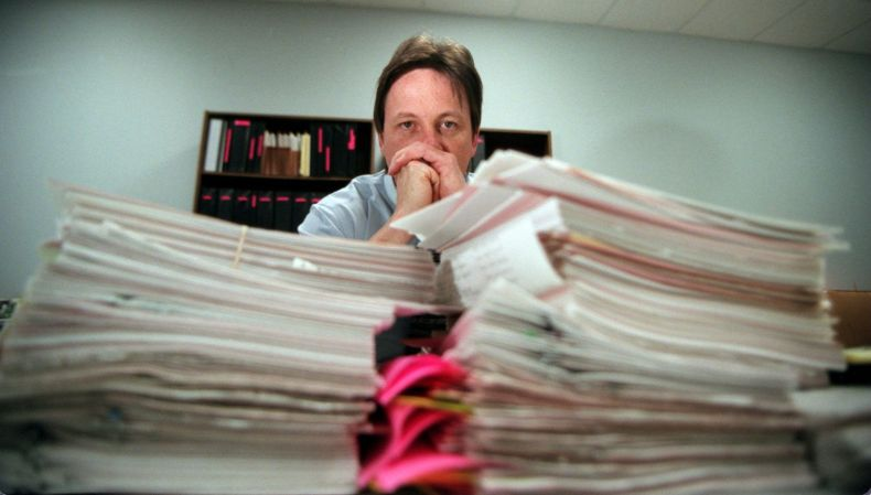 Sgt. Mark Simpson who is head of the Amber Hagerman Task Force sits behind stacks of paper containing tips from the case on March 14, 1996. Investigators said then that time was on their side and are confident they would find Amber's killer.