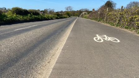 A bicycle sign on the pavement near Belton.