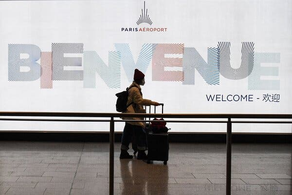 A passenger at Roissy-Charles de Gaulle International Airport, north of Paris, in January.