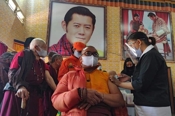 Inoculating a Buddhist monk last month at a school in Thimphu, Bhutan's capital, on the first day of the country's vaccination campaign.The Health Ministry said this month that more than 93 percent of eligible adults had received their first dose of a Covid-19 vaccine.