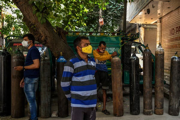 Waiting to refill oxygen cylinders in New Delhi on Tuesday.Families of the sick are filling social media with pleas for oxygen as supplies run low at hospitals or because they are trying to administer care at home.