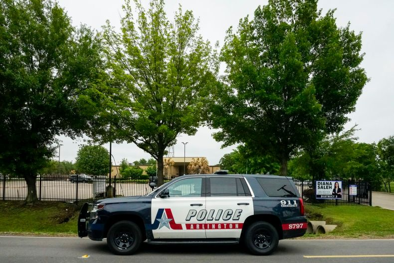"An Arlington police vehicle passes the Dar El-Eman Islamic Center on Mansfield Road on Thursday, April 29, 2021, in Arlington. The mosque was the target of a 2018 ""swatting"" attack in which someone called in a bomb threat. One of the men who took part in that wide-ranging conspiracy, John Denton, was sentenced to federal prison."