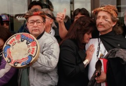 In this 1995 photo from Port Alberni, B.C., artist Arthur Thompson, right, gives the thumbs-up while getting a hug from his wife Charlene after testifying about the child abuse he received from Arthur Plint at Alberni Indian Residential School.