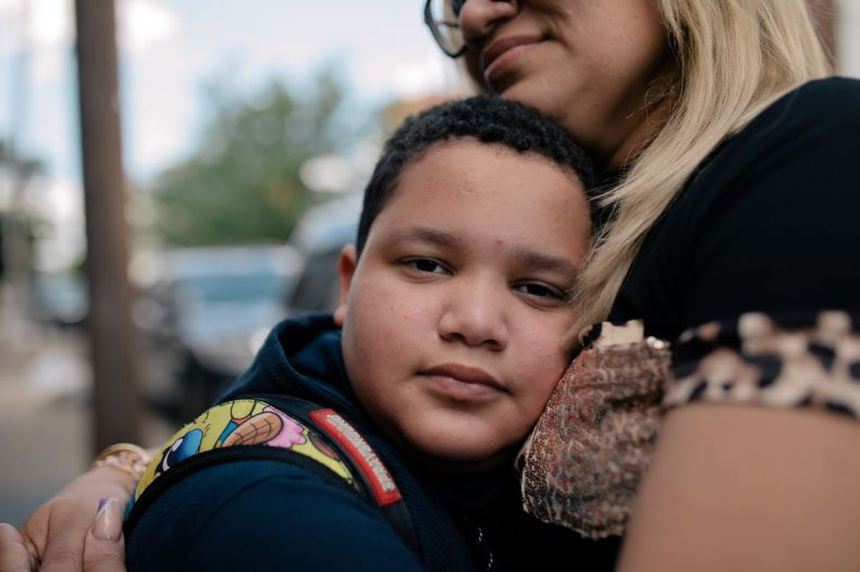 P.S. 89 fifth grader José is embraced by his mother, Milagros Reyes.