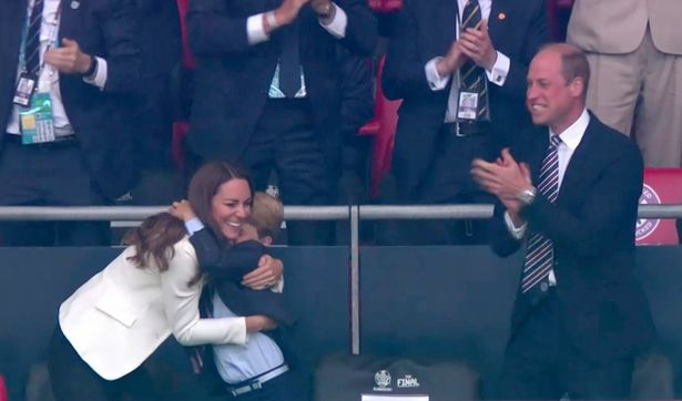 Prince George gives mum Kate a big hug while celebrating England's goal during the Euro 2020 final
