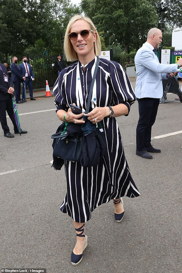 Zara, who was accompanied by her former England rugby player husband, 42, accessorised with oversized sunglasses, a watch which she wore on her left wrist and an over the body blue bag