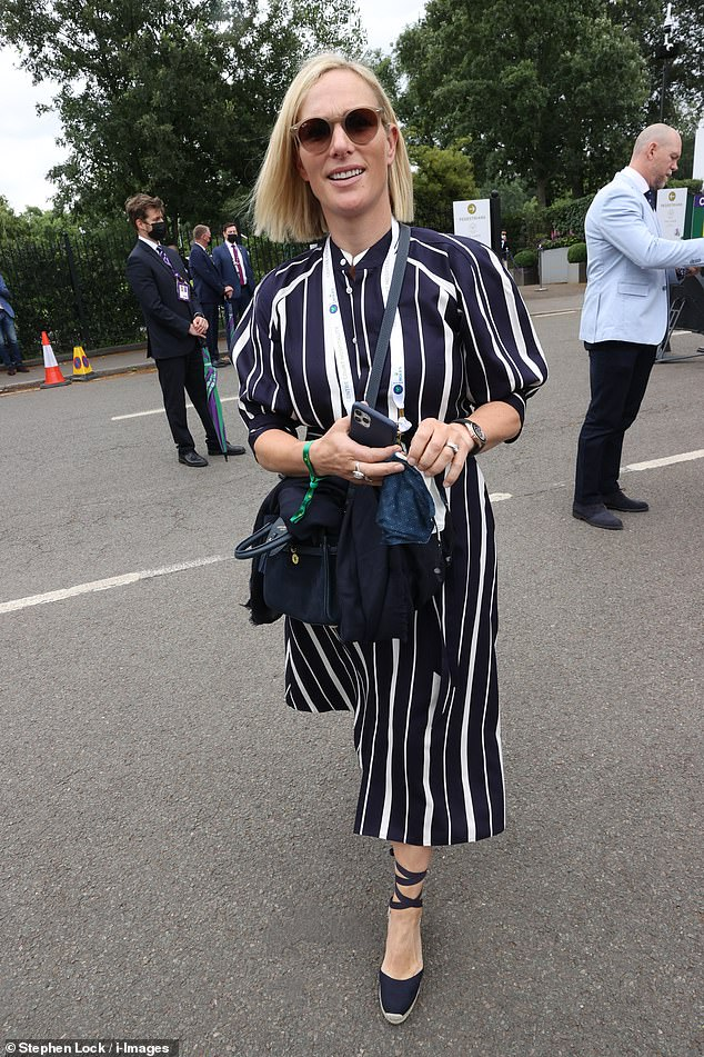 Zara looked effortlessly chic in a navy and white striped dress which she paired with wrap around wedges