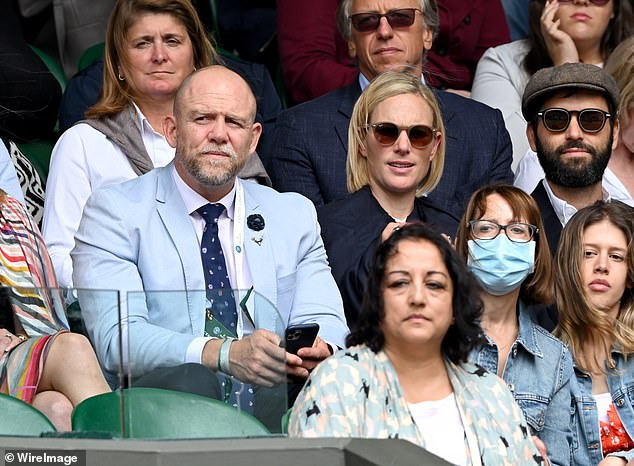 The Queen's granddaughter look typically cool in a pair of oversized sunglasses as she watched the match this afternoon
