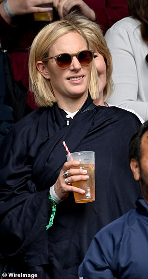 The royal waited for the match to continue on centre court
