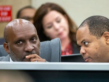 Dallas City Manager T.C. Broadnax, left, listens to Mayor Eric Johnson, right, during a City Council briefing in 2019. Broadnax is preparing the city's next budget, which should be a banner year for the city thanks to federal dollars.