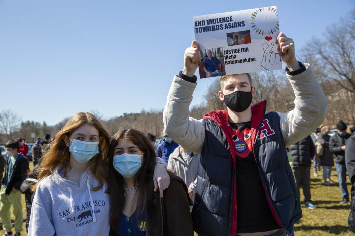 An attendee holds a sign that reads ''End Violence Towards Asians, Justice for Vicha Ratanapakdee'' at a rally organized by the Ardsley High School Asian Students Union against the Asian community in Ardsley, N.Y., in March 2021. (Gina M Randazzo/ZUMA Wire)