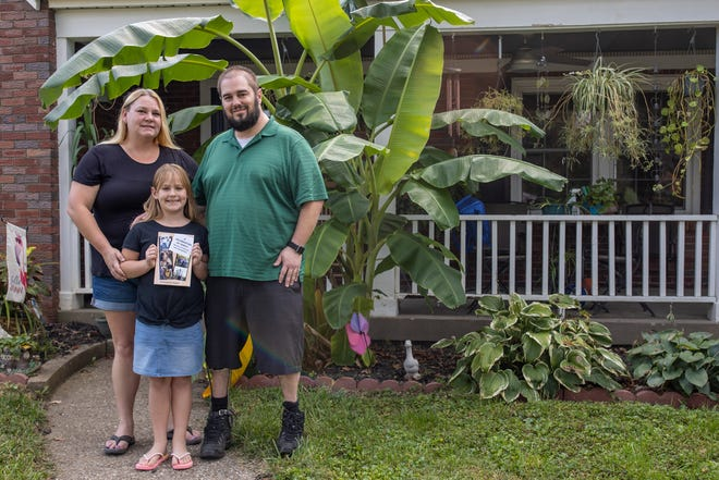 """Shannon Hosey, from left, daughter, Kayla Hosey, and husband, Keith Hosey, are photographed in their front yard in Louisville. The Hosey family is one of many families living with disabilities featured in the new Louisville Center for Accessible Living's published book titled, """"A Celebration of Family.""""  Oct. 4, 2021"""