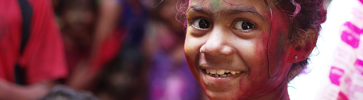 A girl who has been painting smiles