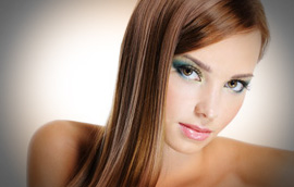 studio portrait of young beautiful brunette with creative makeup and hairstyle paris hair the