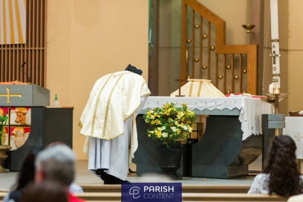 Priest Approaching Altar During Mass
