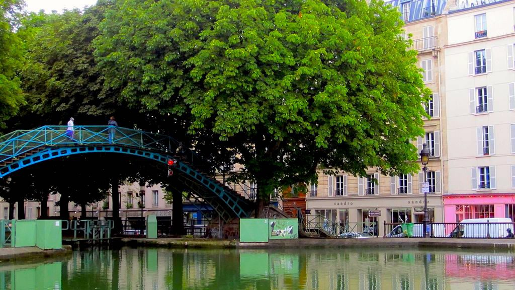 The Canal St Martin in Paris, sometime in March. This is a lovely place to stroll in early spring, by the way. Image: By La Citta Vita (Canal St Martin) [CC BY-SA 2.0], via Wikimedia Commons