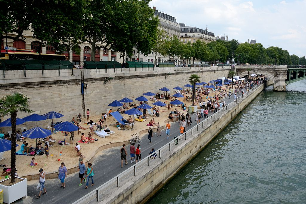 Paris Plages, an ephemeral beach that takes over the Seine each July and August. Image credit: Public domain