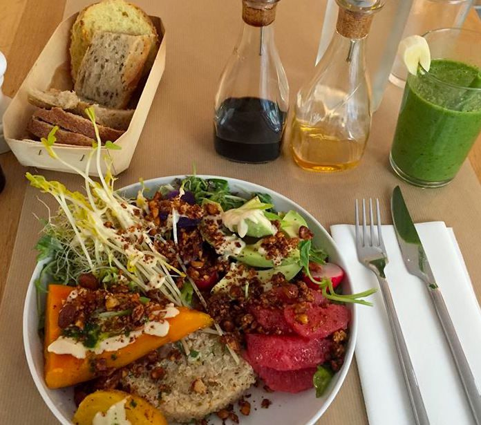 """A raw """"supersalad"""" at Le Potager de Charlotte, accompanied by a fresh-pressed juice. Image: Official FB page"""