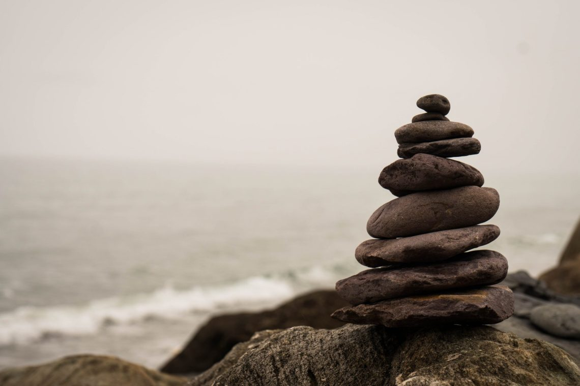 canva-piled-stones-by-the-sea