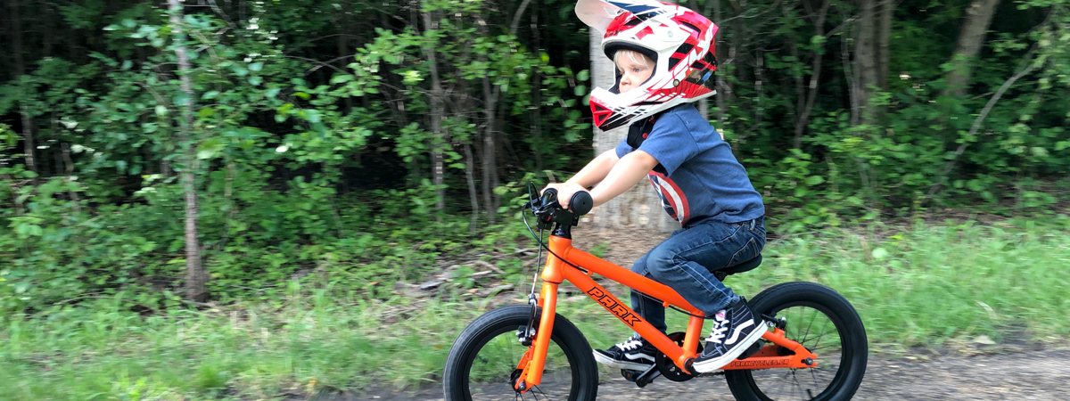 https://i0.wp.com/parkcycles.ca/wp-content/uploads/2019/07/kid-on-PARK-14-pedal-bike-fire-orange-1200x450.jpg?fit=1200%2C450&ssl=1