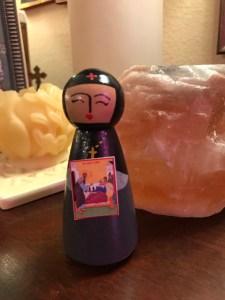 little nun peg doll holding tiny icon