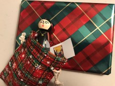 gift wrapped little lost nun peg doll and book, both wrapped in tartan