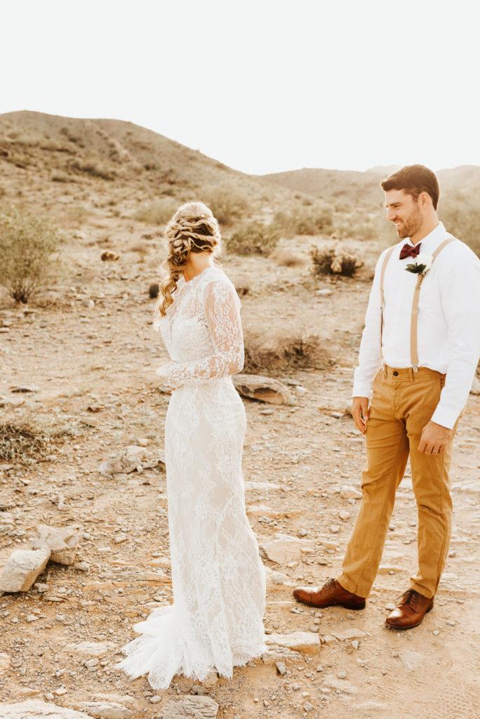 desert bride and groom first look