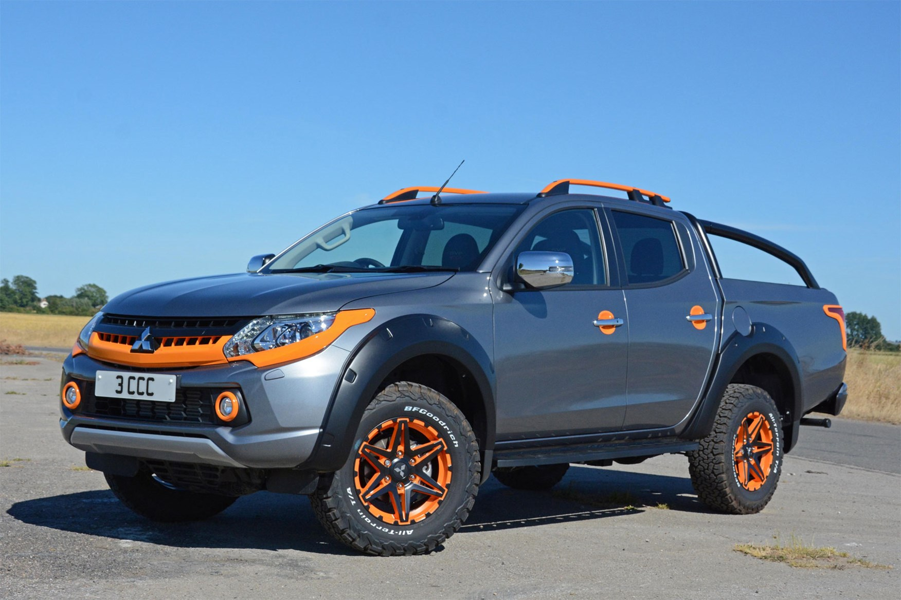 hight resolution of mitsubishi l200 barbarian svp ii review front view grey and orange