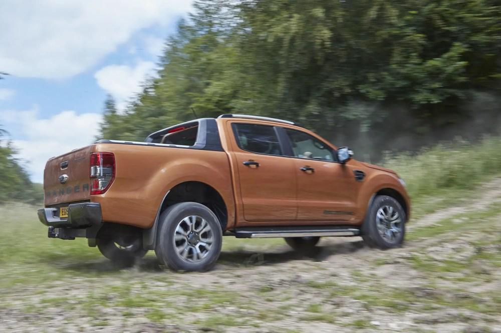 medium resolution of  ford ranger review 2019 facelift model wildtrak orange rear view driving off road