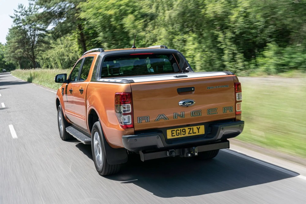 medium resolution of  ford ranger review 2019 facelift rear view driving on road wildtrak