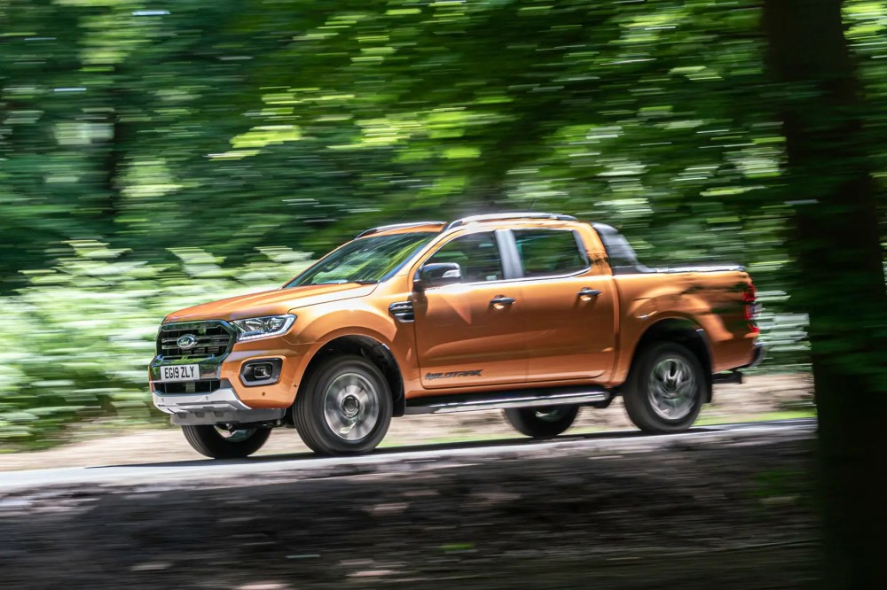 medium resolution of  orange ford ranger review 2019 facelift side view driving through trees wildtrak