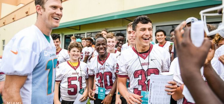 Miami Dolphins Host Marjory Stoneman Douglas Football at Team Practice